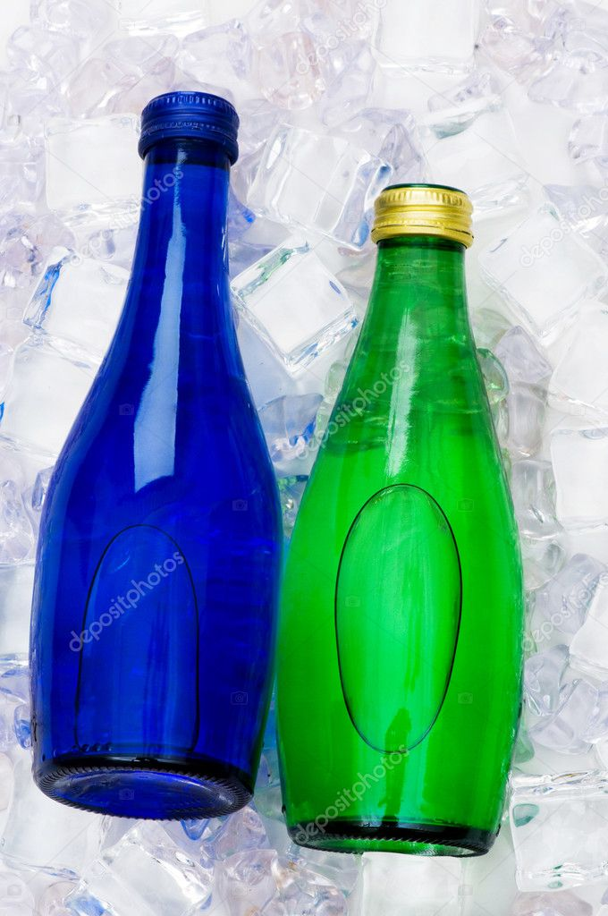 Green bottle of water on ice cubes — Stock Photo #1632692