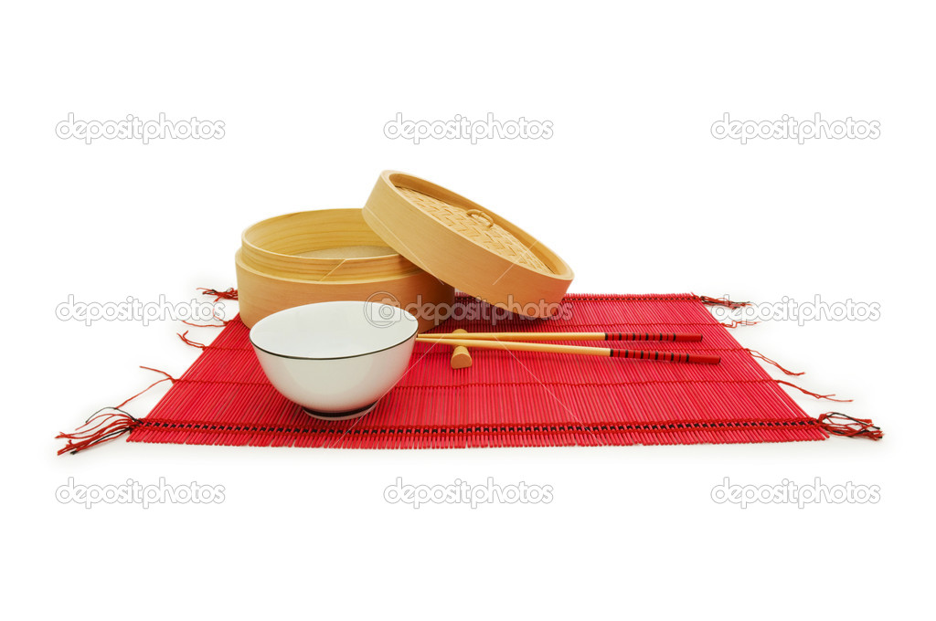 Chopsticks and bowl on the bamboo mat — Stock Photo #1636812