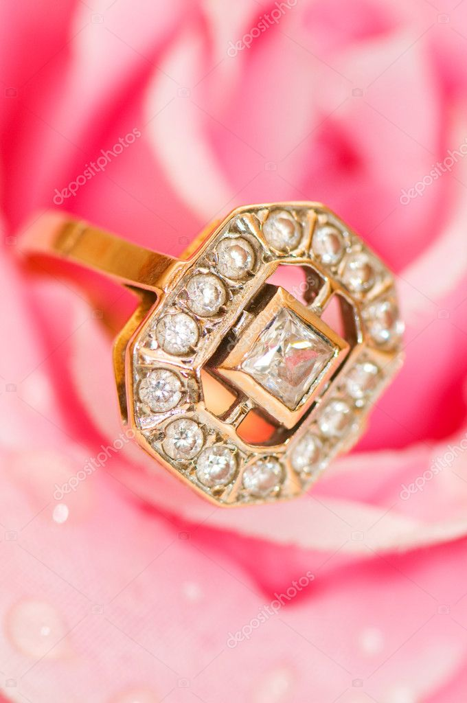 Golden ring against pink rose  Stock Photo #1636978