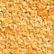Background with yellow cereal flakes — Stock Photo