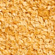 Background with yellow cereal flakes - Stock Photo