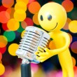 Vintage microphone and smilie — Stock Photo