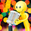 Stock Photo: Vintage microphone and smilie