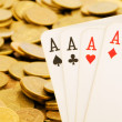 Royalty-Free Stock Photo: Four aces and lots of gold coins