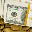Close up of dollars and coins — Stock Photo