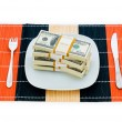 Financial concept - eating money - Stock Photo