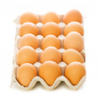 Many eggs isolated on the white — Stock Photo