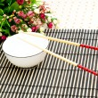 Chopsticks and bowl — Stock Photo