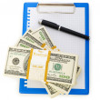 Stack of dollars and blank pad — Stock Photo