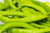Green peppers in the plate isolated — Stock Photo