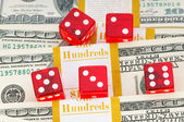 Red dice and dollars — Stock Photo