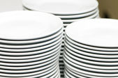 Stacks of empty white plates — Stock Photo