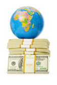 Globe and stack of dollars isolated — Stock Photo