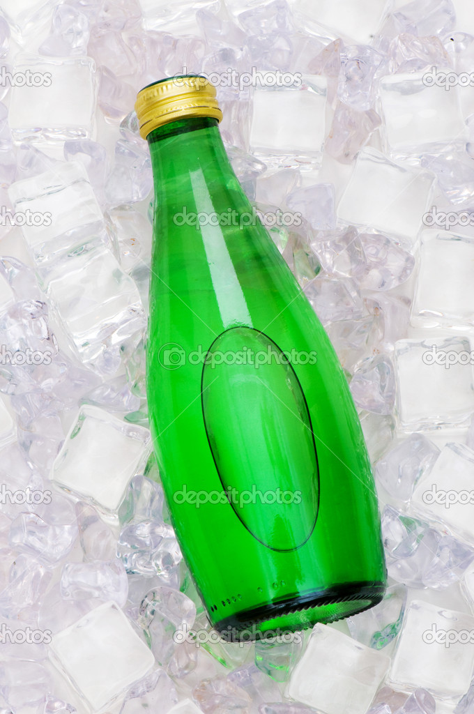 Green bottle of water on ice cubes — Stock Photo #1921066