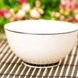 Traditional asian bowl and flowers — Stock Photo #1936586