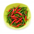 Stock Photo: Peppers in plate isolated