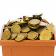 Many coins in the clay pot — Photo