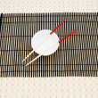 Chopsticks and bowl on the bamboo mat — 图库照片
