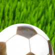 Sport concept - football on the grass — Stock Photo