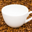 White cup and background of coffee — Stock Photo