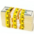 Financial concept - measuring money - Stock Photo