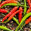 Red and green peppers on pepper — Stock Photo #1938966