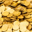 Pile of golden coins isolated — ストック写真