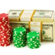Dollar and casino chip stacks on white — Stock Photo #1939459