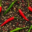 Red and green peppers on pepper — Stock Photo #1939565
