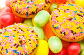 Sweet cakes and colourful gums — Stock Photo