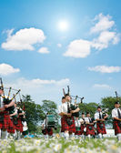 Marching scottish band marching — Stock Photo