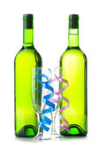 Bottle of wine and glass with streamer — Stock Photo