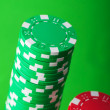 Stack of red and green casino chips — Stock Photo