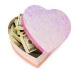 Heart shaped gift box and dollars — Stock Photo