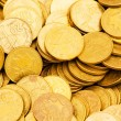 Pile of golden  coins isolated on white — Stock fotografie