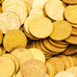 Pile of golden coins isolated on white — Stock Photo