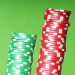 Stack of red and green casino chips - Photo