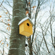Stock Photo: Bird house on the tree in winter