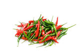 Red chili peppers isolated on the white — Stock Photo