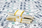 Background with many american dollars — Stock Photo