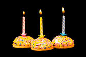 Cupcakes and candles isolated — Stock Photo