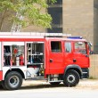 Fire engine at the scene of city fire — Stock Photo