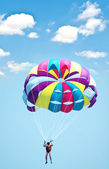 Multi coloured parachute over the sky — Stock Photo