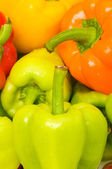 Bell peppers arranged at the market — Stock Photo