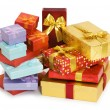 Many giftboxes isolated on the white - Stock Photo