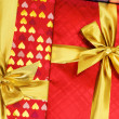 Close up of red gift box with ribbon — Stock Photo