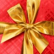 Close up of red gift box with ibbon — Stock Photo