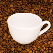 White cup on the background of coffee — Stock Photo