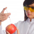 Woman scientist injecting chemicals — Stok fotoğraf