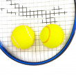 Two tennis balls and racquet isolated - Stock Photo